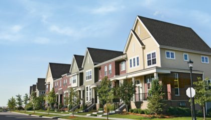 Row of Suburban Townhouses on Summer Day Getty